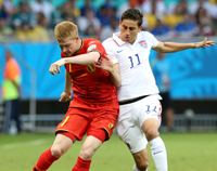 Belgium edge out brave USA