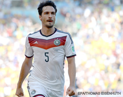 Hummels heads Germany into semis